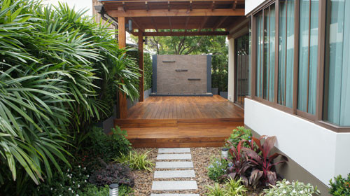 Gold Teak Deck with Modern Water-Wall Feature - Tropical ...