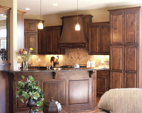 Custom Cabinets - Stained maple cabinets with a custom wood hood