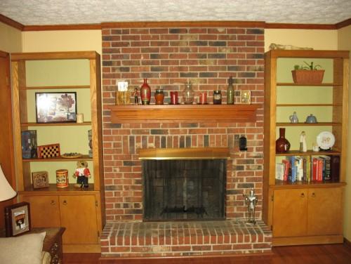 Decorating around a red brick fireplace