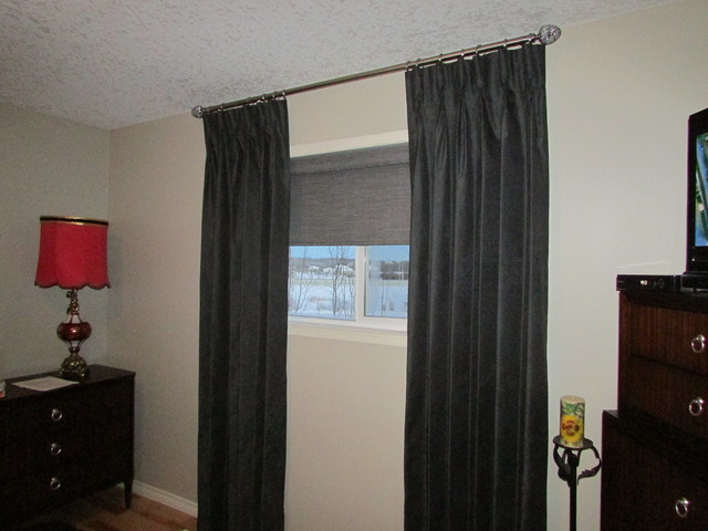 Stationary Pinch Pleat Drapes over operable roller shade traditional ...