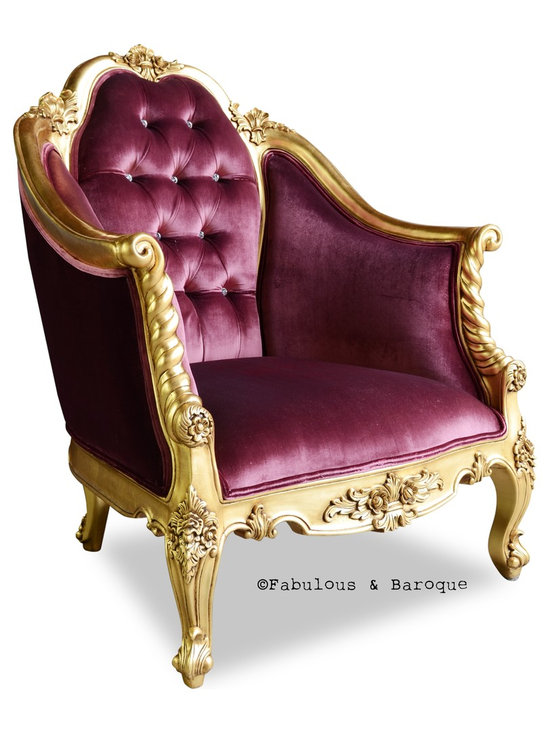 Fabulous and Baroque's Gold Violette Chair - Searching for the last piece to adorn your living room? Looking for something tasteful, elegant and refined? Behold the Violette Chair! The classic and timeless beauty of the Violette will surely make a statement, whether sitting next to a fire in the study, or in a luscious entryway; no will be able to deny its commanding presence.  The arched high back and tapered arms allow this chair to provide a sense of regal security and authority all at once. Finished in a brilliant gold leaf glaze and upholstered in a plush aubergine velvet with upholstered buttons.