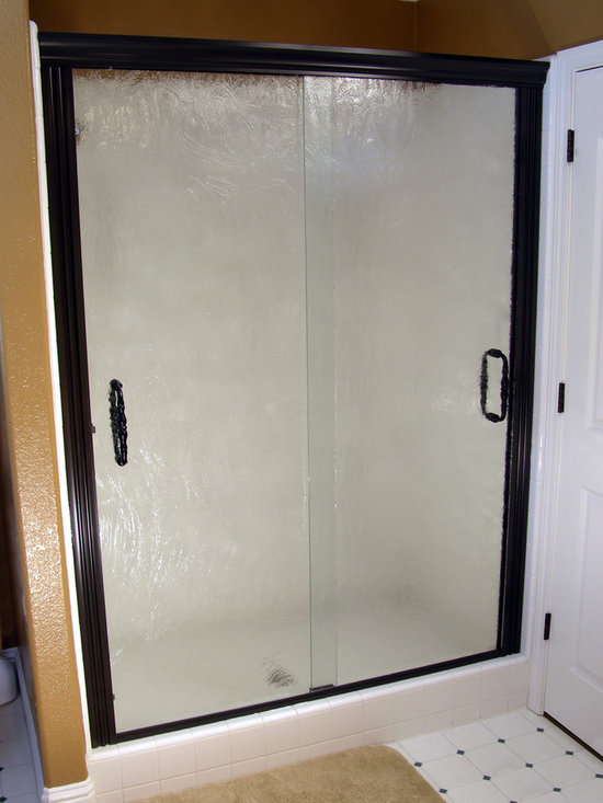 Custom Glass Shower Door Installations - Fogged and textured glass for shower door.