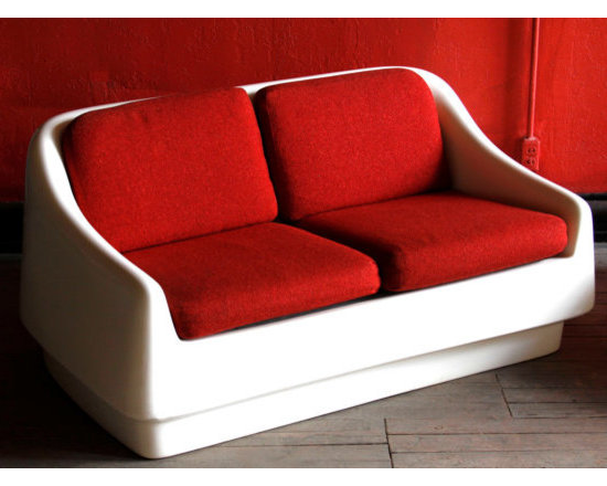 Mod Space Age Couch - We fell hard when we spotted this out-of-this-world Space Age couch. The fiberglass shell is so sleek, so mod, so bright. And curling up on this sofa is beyond comfortable...