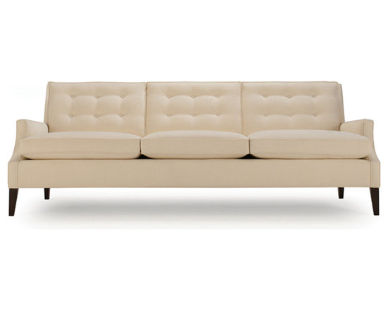 Conner Sofa - Our Conner sofa features a modern scoop-arm with stylishly slender seat and back cushions. The cushions are semi-attached for a look that's casual yet stays neatly in place, while the back cushions feature decorative button tufting.