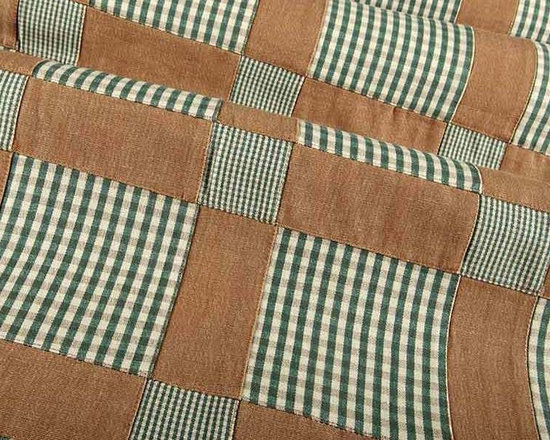 Patchwork Fabric in Olive - Patchwork Fabric in Olive is a fun fabric that works perfectly for upholstery, drapery, or bedding and pillows. This plaid fabric has a rustic vibe perfect for country inspired interiors. Made in India from 100% cotton. Cleaning code: S. Repeat: 6 3/4″V 6 3/4″H; Width: 54″.
