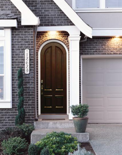 Jeld-Wen A110 Mahogany Woodgrain Radius Top Panel Door Sequoia Finish traditional-front-doors