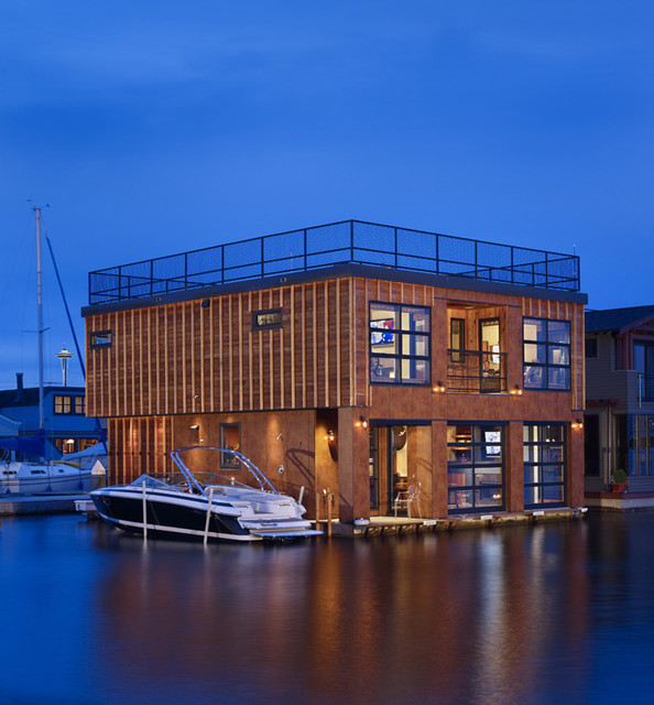 Lake Union Float Home.  Sunset view from the water. modern exterior