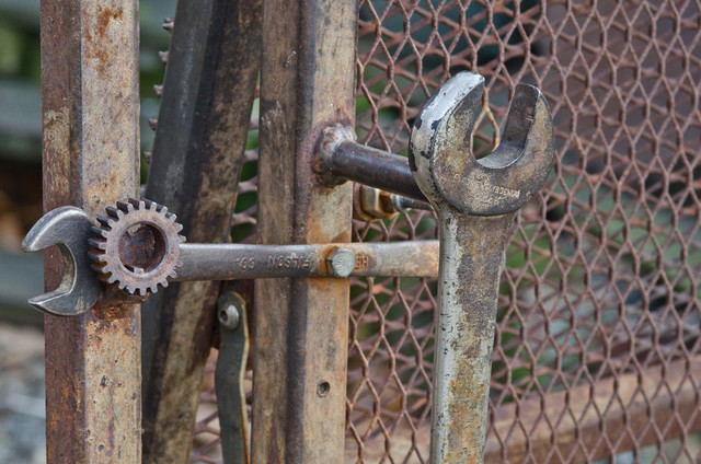 Wrenches are reused for the gate handle and latch eclectic exterior