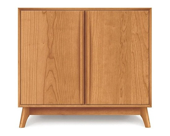 Copeland Furniture - Catalina Cherry Two-Door Buffet | Copeland Furniture - Made in Vermont by Copeland Furniture.The Catalina Cherry Two-Door Buffet offers clean mid-century modern style for the dining room. This simple side buffet features a two door cabinet with sleek integrated wooden bar door pulls, soft-close (self closing) door hinges, and adjustable shelving. The Catalina Cherry Two-Door Buffet is impeccably hand-crafted from solid cherry hardwood and given a Natural wood finish. Copeland Furniture uses sustainably harvested hardwoods from the American Northern Forest. All lumber used by Copeland Furniture comes from within 500 miles of their factory in Vermont, thus reducing fossil fuel consumption and carbon dioxide emissions from transportation. The environmental values of preservation and stewardship are reflected in every piece of furniture produced by Copeland Furniture. Product Features:  Two-doors with integrated door pulls Soft-close (self-closing) hinges Adjustable cabinet shelves Natural wood finish Made in the U.S.A. of solid cherry wood