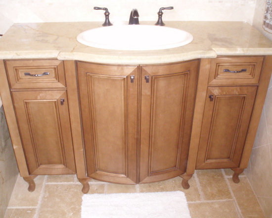 European Style Bathroom Cabinets - This beautiful maple pullman has two radius doors that are bumped out in front of the sink.  Queen Anne feet distinguish this maple cabinet even further.  Please visit our web site to see more photos of this bathroom and many more.