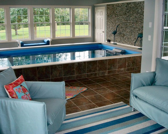 Original Endless Pools® - From the watery blues of the upholstery and Endless Pool to the tile's golden earth tones to the intricate wall mosaic, natural hues and textures define this room - elegant choices all given this panoramic outdoor view!
