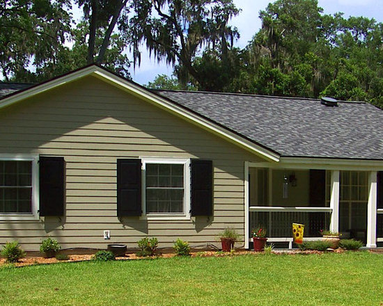 Home Renovation in Beaufort, SC - Complete Home shot with functional Western Red Cedar, panel shutters from Timberlane.