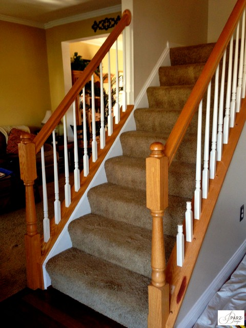 Iron Stair Installation replaced Woodre stained Railing