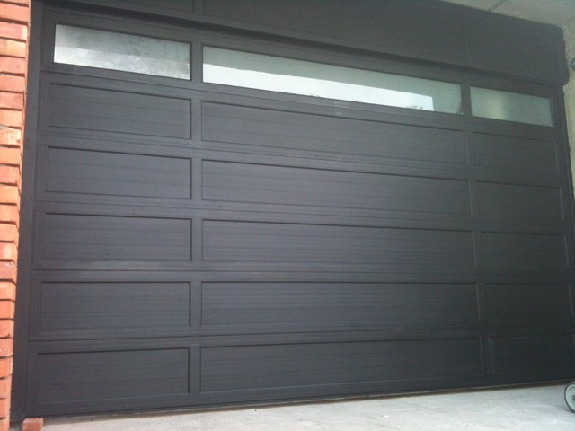 Glass garage door living room - O Leary Stacking Garage Door Modern Garage Doors And