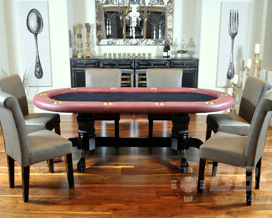 The Elite - The Elite poker dining table is exactly what it sounds like - confident and classy. An impressive centerpiece for any occasion, the Elite is a serious battlefield capable of high stakes wars, but is also equally comfortable hosting your next dinner party. Shown without solid wood dining top, with premium lounge chairs, sold separately.  Price starts at $1,579.
