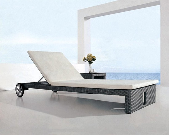 Wulla Patio Lounge Set - This contemporary lounge set includes both the chaise lounge and side table.