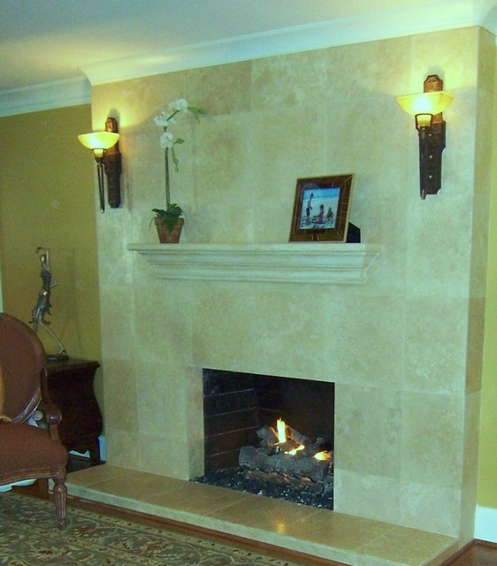 Limestone fireplace with unique wall sconces Contemporary wall sconces for living room