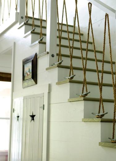 pasamanos de escalera hecho con soga