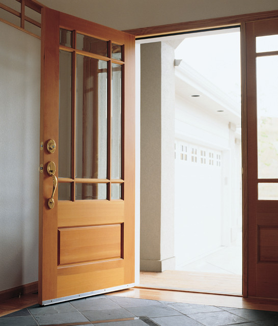 Waudena millwork wood entry door front doors by for Door design houzz