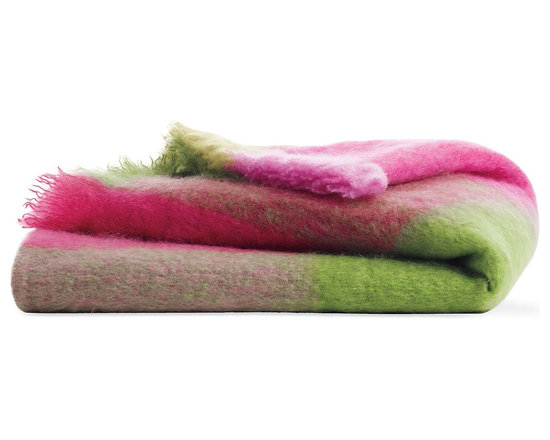 Mohair Throw - Wrap yourself in this luxuriously soft Mohair Throw and you'll understand why mohair, which is made from the hair of the Angora goat, has been prized since the 1500s. As warm as a hug, the high-quality mohair fibers are naturally durable and breathable. Mohair's inherent strength and flexibility has led to its use in a wide range of applications since Angora goats were brought to the West in the mid-1800s – from blankets and scarves to train seats and cowboy chaps. Using all-natural vegetable dyes and only natural fibers, our 100% brushed Mohair Throw was woven at a mill in County Wicklow, Ireland, which has been manufacturing tweeds and blankets since 1723. Made in Ireland.