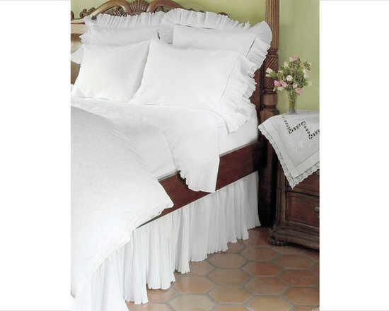 Nottingham Sheet Set, Shams & Bed Skirt - Escape the stresses of everyday life with this dreamy bedding collection. The simple, yet, gorgeous tiny pleated ruffled-trim, is accented with a beautifully constructed large hemstitch and graces the flat sheet, pillow slip, pillow shams and bed skirt providing pure romance to snow-white cotton. The cascading and uniquely ruffled and flowy bed skirt adds unique texture to a variety of bedding to create an ethereal feel in the bedroom. The beautifully ruffled boudoir pillow sham perfectly coordinate with our other bedding collections (sold separately).  Made in Portugal.