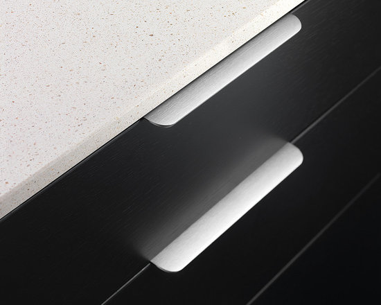 Round Edge Pulls - DP212 - Traditional tab pull design takes a rounder, more aerodynamic approach for a softer look. Extremely lightweight with ultra thin construction and sits nearly flush with the surface. Smooth curves on the downward sloping front edge create a sturdy and comfortable grip. Screws included.