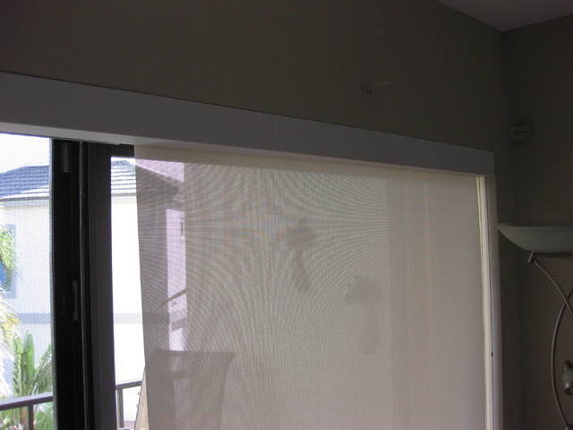 Three Solar Shades On Sliding Glass Door With Continous