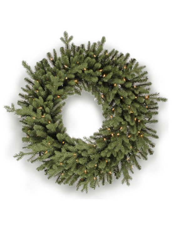 Winward Designs - Christmas Pine Wreath 24 inch - Our Traditional Wreath embodies the magic of a Christmas tree with a simply festive display of fir. The classics have lasting power for a reason and sometimes you just want to decorate your home with a classic symbol of the season.