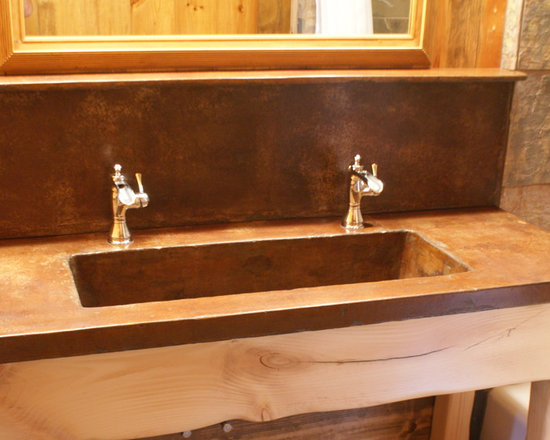 Sinks and Vanities - Integral sink top, backsplash and shelf. Hand trowelled finish, stained concrete.