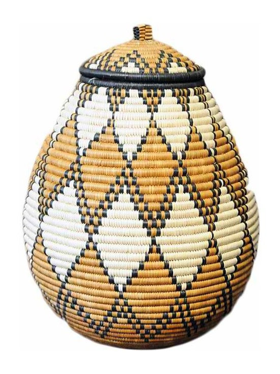 Zulu Basket - To create these traditional baskets, weavers use strips of naturally waxy palm fronds wrapped around coils of wild grasses. Zulu baskets are an integral part of the Zulu custom.