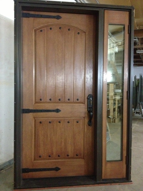 Swinging entry door designs traditional front doors for Traditional wooden door design ideas