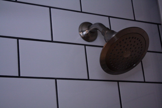Oversized White Subway Tile Contrasts With Charcoal Grout