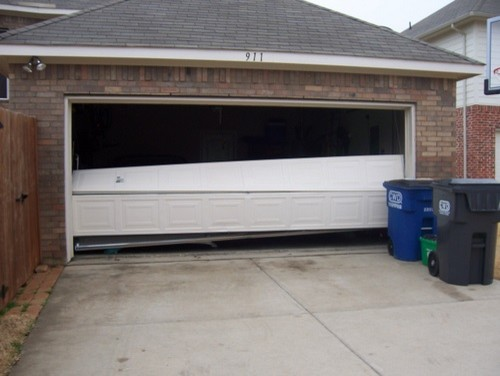 Broken garage doors garage and shed dallas by a1 for A1 affordable garage door