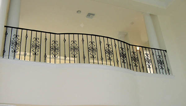 Traditional interior decorating ideas - Interior Wrought Iron Curved Balcony Rail Traditional
