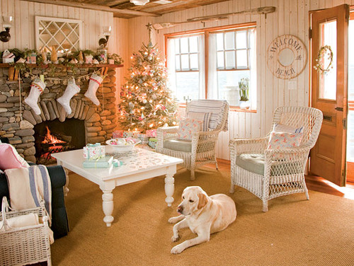 holiday-decorated living room with white furniture and dog lying on the carpet