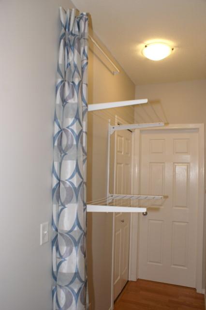 Hidden Clothes Line - Contemporary - Laundry Room - calgary