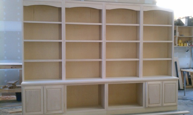 Custom built in library book case pre stained for Pre built cupboards