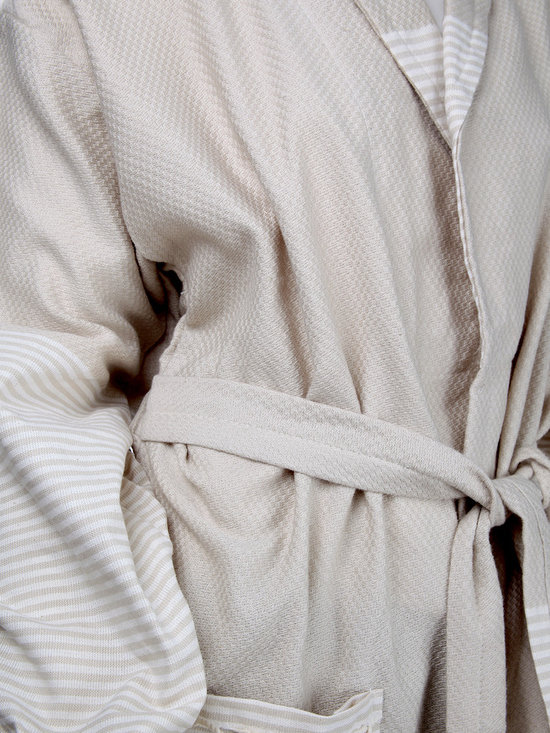 Turkish Hammam - Beige unisex Turkish pestemal bathrobe.This shawl collar bathrobe made of self checkerboard patterned and 100% cotton pestemal. Part of the collar, skirt, the arm ends, edges of waistband of this Turkish towel bathrobe adorned with embellished ecru stripes.