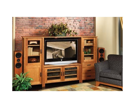 FREMONT MEDIA CABINET - The Fremont media cabinet is an organizer for all seasons. Its many features are symbolic of the variety of artworks found in its geographical namesake. Two media piers flank a center console stand. The glass panel doors allow for easy viewing and remote use. The panel door to the left hides storage for a clean look. The drawers on the right provide quick retrieval of movie and music storage. The shelves are completely adjustable to allow for precision fitting of your media consoles and accessories. The center console has two glass panel doors and adjustable shelves for even more component storage. The open center provides plenty of space for the largest of televisions.