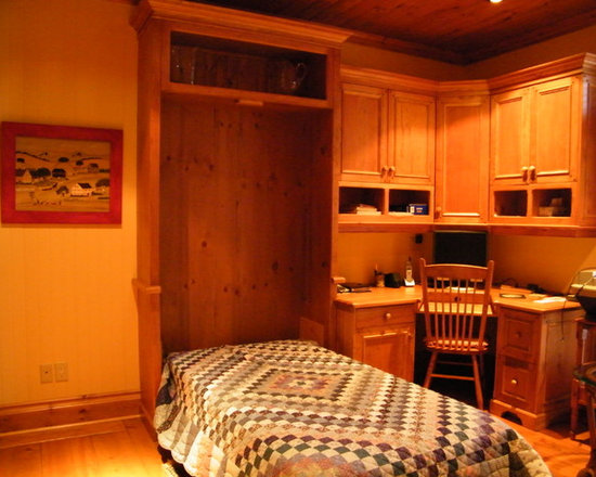 Secret Sleeper Murphy Beds - Twin murphy bed,in open position. Attached to corner desk in stained wood finish. Ideal for overnight guests