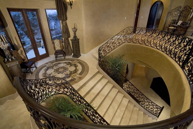Drapery challenge in high staircase entry area mediterranean