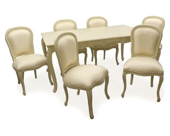 Chichi Furniture Exclusives. - The French dining table classic, a beautiful ornate dining table and six chair set, finished in antique ivory. Featuring intricate carved cabriole style legs and table trim, comes complete with six upholstered dining chairs finished in a champagne colour silk fabric. A real centre piece of your dining room!