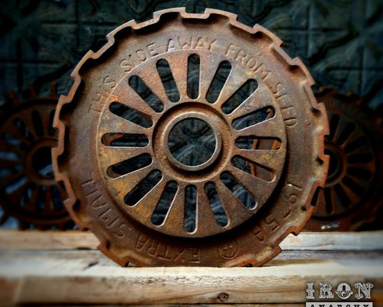"""Antique Industrial Gear Decor - Fantastic old gear of thick cast iron in a hardcore industrial design. Engraved text to make it even more intriguing! Reclaimed lumber display stand. 7 5/8"""" diameter."""