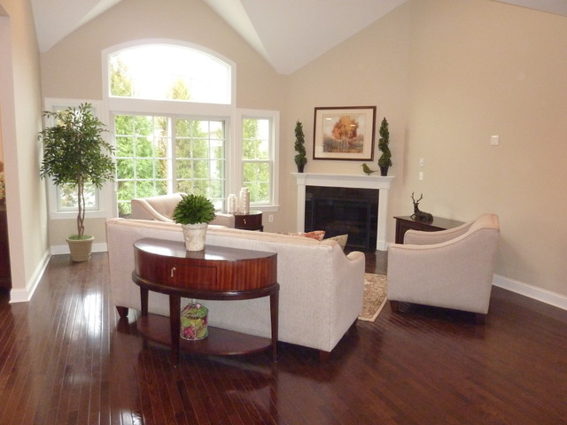 Model home living room transitional furniture curved Model home family room pictures