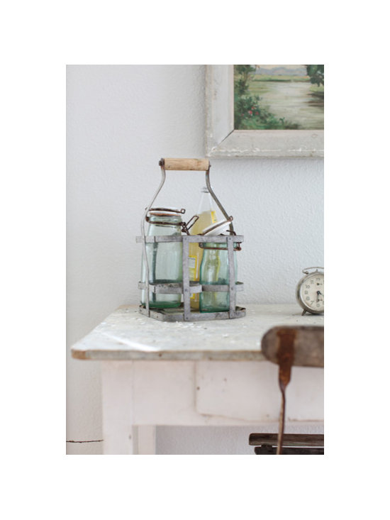 Antique French Bottle Carrier - This is an an antique french zinc bottle carrier.It has four slots to put bottles in.