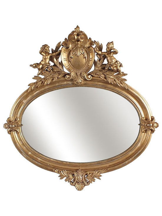 Antique Oval Mirror with Cupids on Top - This a hand carved oval mirror with cupids on top. The mirror is on a gold color with distressed finish.
