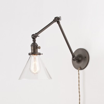 Bronze-plated wall light with clear glass shade