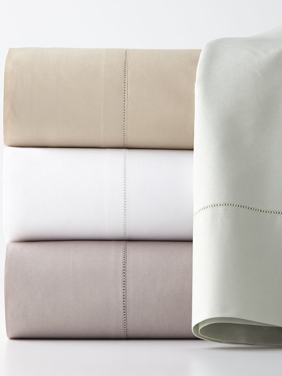 SFERRA - Two King 406TC Percale Pillowcases - WHITE (KING) - SFERRATwo King 406TC Percale PillowcasesDesigner About Sferra:The story of Sferra begins at the turn of the 19th century when Gennaro Sferra left Italy for the United States in the hopes of finding a market among the Atlantic Coast for his intricate Venetian lace cuffs and collars. By 1912 he and his family had opened up shop on famed Fifth Avenue in New York City. A generation later Gennaro's two sons expanded their family's collection to include the most luxurious European linens of the day from renowned double damask from Ireland to Alençon laces from France to elaborate embroideries from Belgium and Switzerland. In 1977 the ownership of Sferra was sold by the family to Paul Hooker under whose keen business savvy and passionate stewardship this classic brand has flourished over the years. With the aid of great advancements in design and production techniques Sferra has secured its rightful position as a leader in the luxury linens industry. Above all the secret to the enduring reputation of the Sferra brand is the same now as it was a century ago only the finest materials are used in any product bearing the Sferra name.