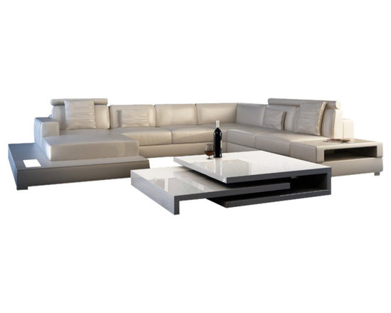Scene Furniture - Spring Leather Sectional - This large elegant sectional sofa is hand produced with genuine Italian leather and is designed with an included side table & side light. The removable side table, which is seen in image 5, adds much usefulness.