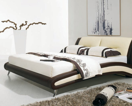 Donatelli Bed Frame - Cool clean lines combine with a hip two tone genuine leather upholstery to create the perfect addition to your modern bedroom decor in the Donatelli Leather Bed Frame.